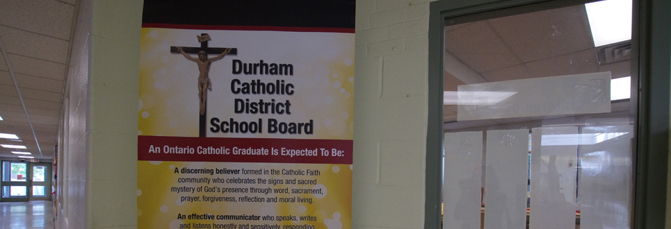 Stand up sign stating the Catholic Graduate Expectations.