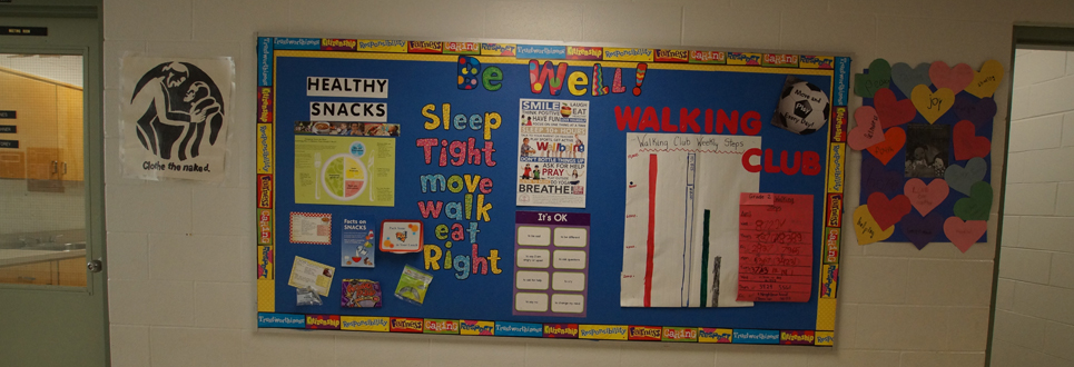"""Be well"" bulletin board with several posters on best practices in mental and physical health."